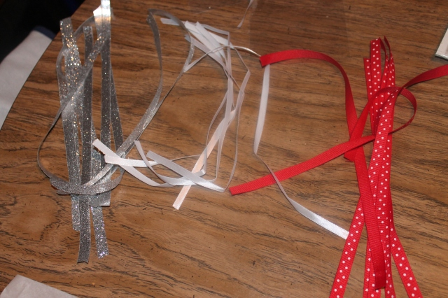 Some glittery silver, white, and polka dot red ribbon to tie the cake pops with!